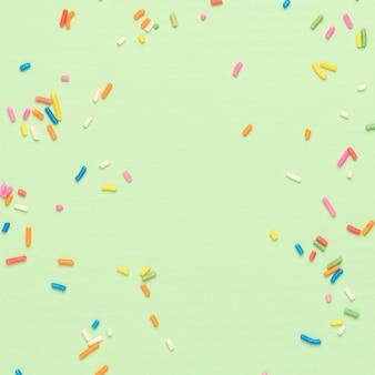Suiker bestrooit groene tekstruimte