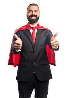 Super held zakenman met duim omhoog
