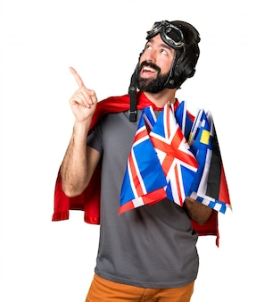 Superheld met veel vlaggen die wijzen
