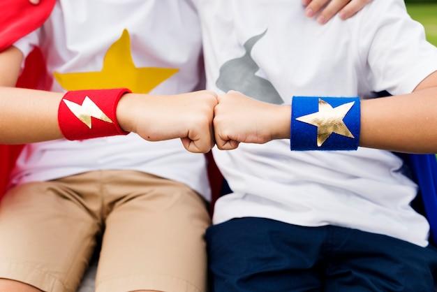 Superheroes friends fist bump happiness concept