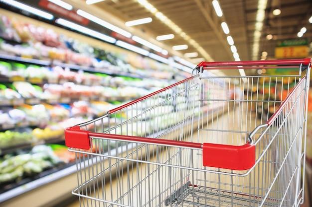 Supermarkt-supermarkt met lege winkelwagen