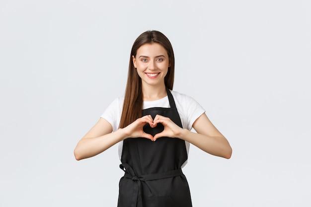 Supermarktmedewerkers, kleine bedrijven en coffeeshops concept. mooie vriendelijk ogende barista