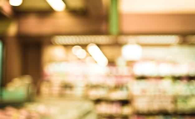 Supermarktopslag vage achtergrond met bokeh, defocused licht in opslag