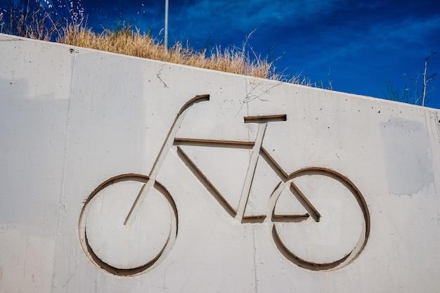 Symbool van een fiets die een fietspad aangeeft om veilig te trappen.