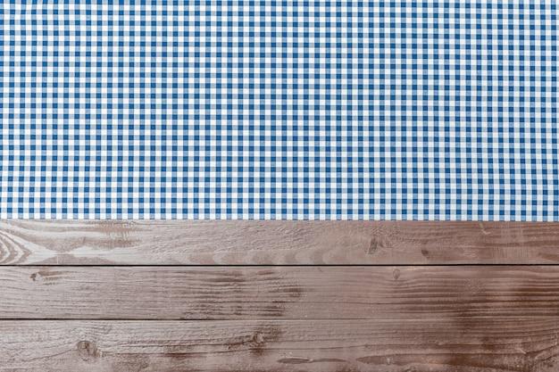 Tafelkleedtextiel op houten achtergrond