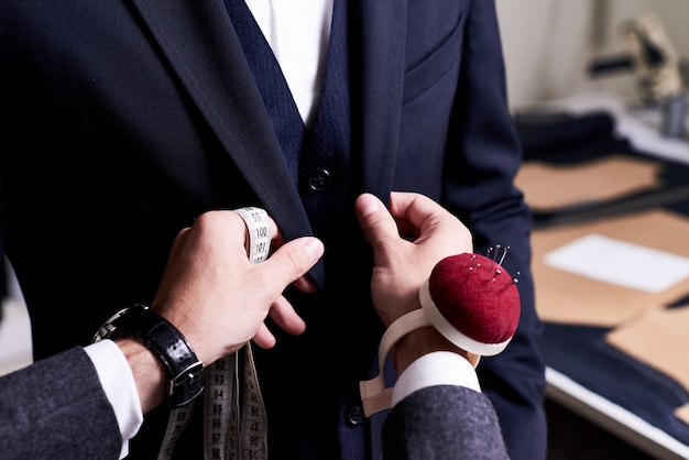 Tailor pinning custom suit