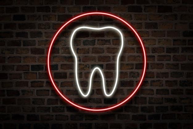 Tand, neon bord op een bakstenen muur. tandheelkundige kliniek concept, eerste hulp.