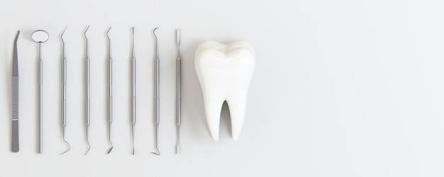 Tandartshulpmiddelen met tanden op witte achtergrond.