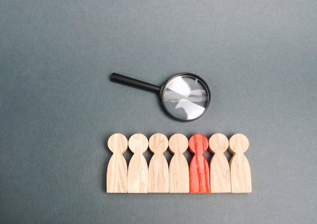 Team van arbeiders en vergrootglas. zoek naar mensen. aantrekking om te werken. human resource