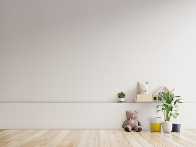 Teddybeer en konijn pop in de kinderkamer op de muur.