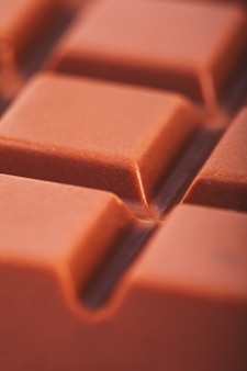 Tegel melkchocolade close-up als achtergrond