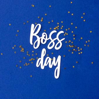 Teken met belettering van de dag van de baas