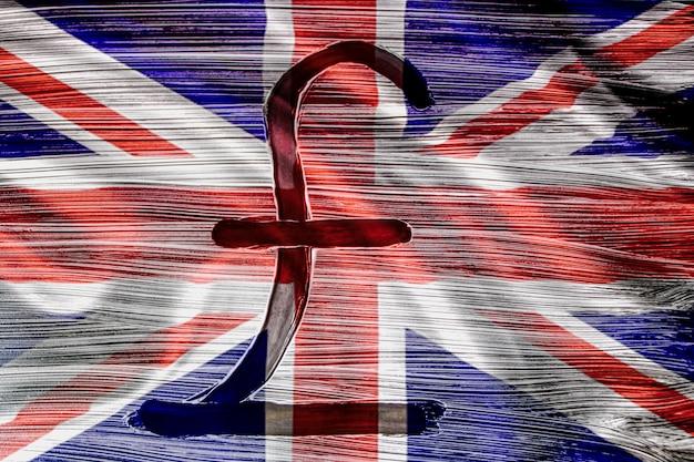 Teken van het pond sterling tegen de achtergrond van de vlag van groot-brittannië