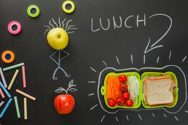 Tekening op het schoolbord met lunchtijd