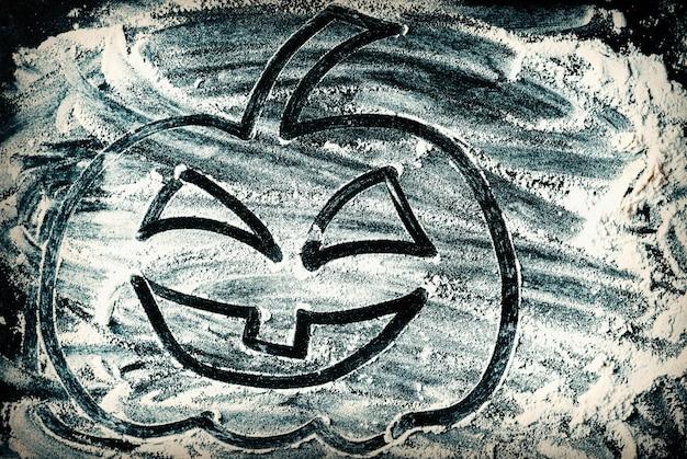 Tekening van halloween-lantaarn van de pompoen de hoofdhefboom op de oppervlakte van de tarwemeel