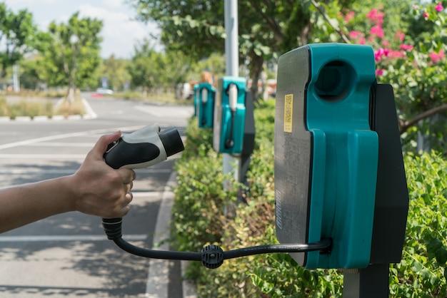 Tekens voor een machtslevering voor elektrische auto's