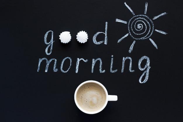 Tekst goedemorgen, zonkrijt op zwarte achtergrond
