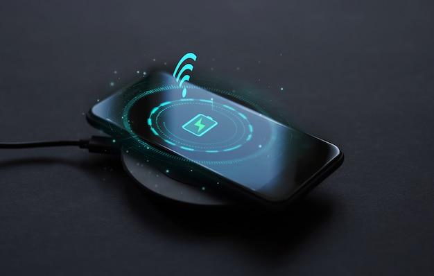 Telefoon aangesloten op de draadloze oplader concept van moderne technologie