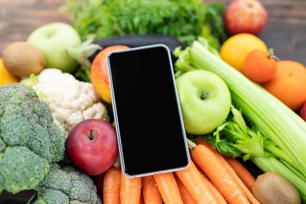 Telefoon mock-up zwart scherm voor mobiele app gewichtsverlies dieet gezond voedsel afhaalmaaltijden voedingsplan online bezorgservice