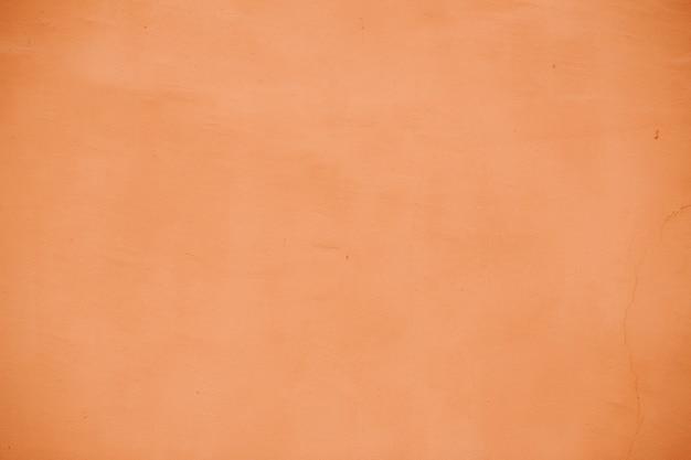 Terracotta of perzikkleurige gepleisterde muur. ontwerpelement, achtergrond, textuur.