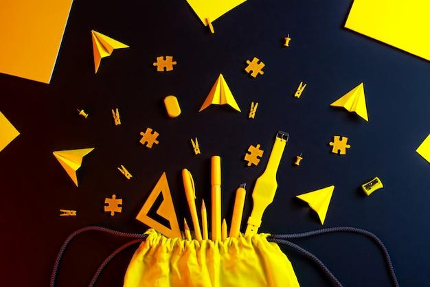 Terug naar school. compositie met gele schoolspullen: kleurpotloden, stiften, liniaal, verf.
