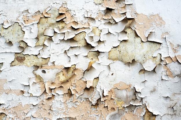 Textuur achtergrond gebarsten peeling verf gips.
