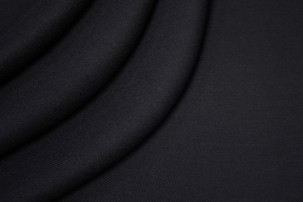 Textuur, achtergrond, patroon. zwarte wollen stof voor maatwerk.