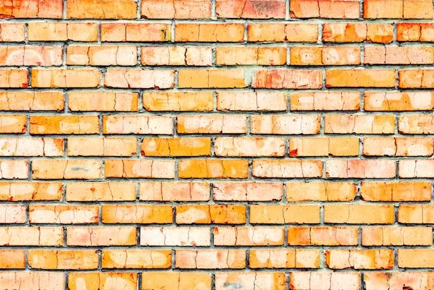 Textuur, baksteen, muur, achtergrond. baksteentextuur met krassen en scheuren