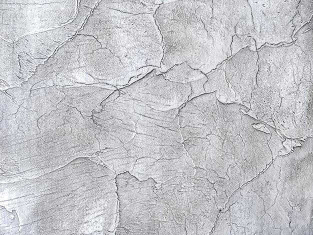 Textuur decoratief zilveren pleister die de oude schilmuur imiteren.