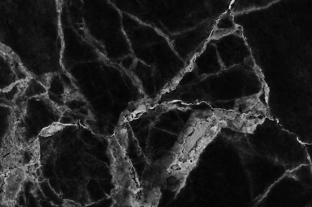 Textuur en achtergrond van de patroon de de zwarte marmeren vloer