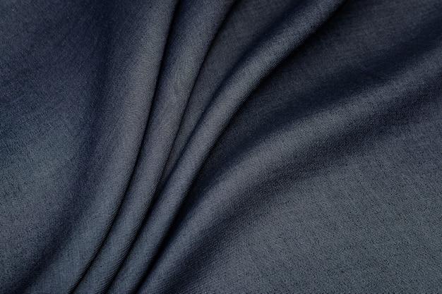Textuur, grijze katoenen stof voor het naaien van kleding.