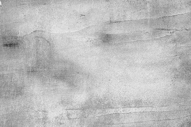 Textuur, muur, betonnen achtergrond. muurfragment met krassen en scheuren