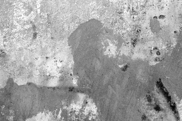 Textuur, muur, concrete achtergrond. muurfragment met krassen en scheuren