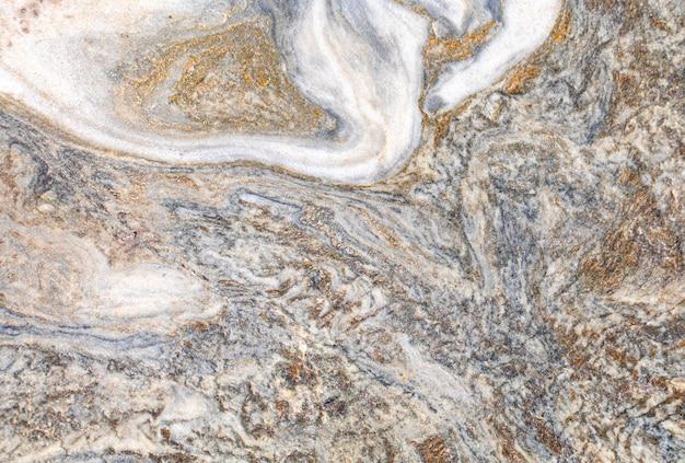 Textuur of achtergrond marmer, natuursteen. met lichte en donkere delen.