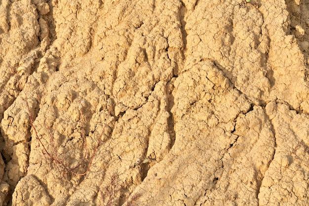 Textuur onvruchtbare aarde lichtbruine rots.