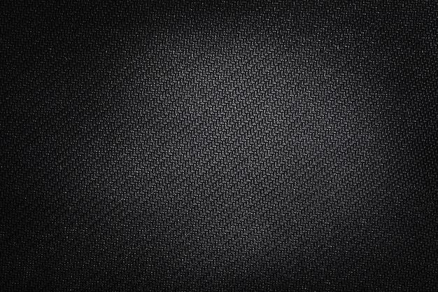 Textuur technisch weefsel met rubberen coating. zwarte achtergrond.