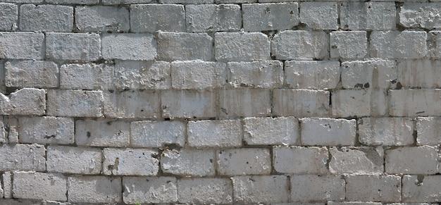 Textuur van bakstenen muur van hulpstenen onder helder zonlicht