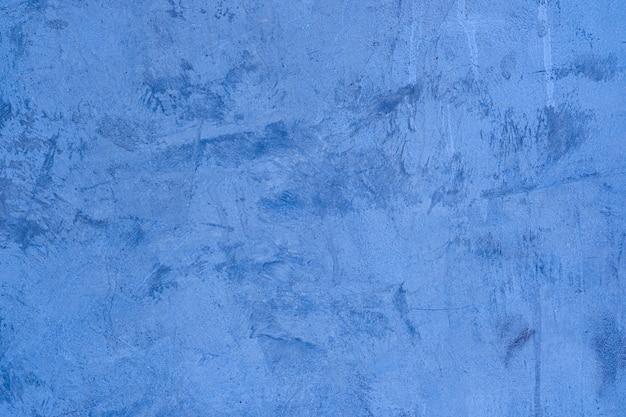 Textuur van blauwe betonnen muur. achtergrond van interieur design tapijten
