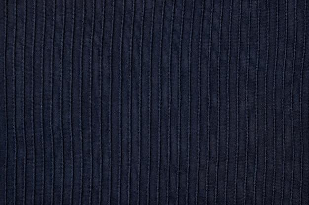Textuur van blauwe gebreide stof, close-up, hoogste mening