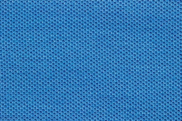 Textuur van blauwe shirt stof.