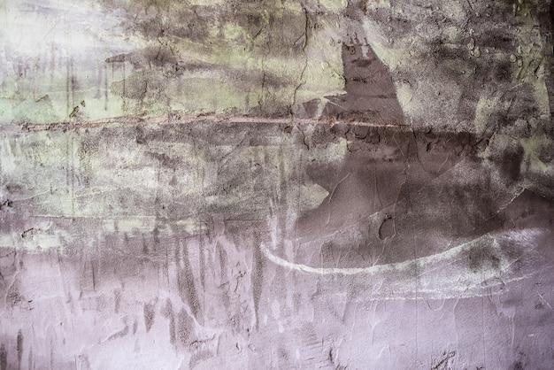 Textuur van cement. achtergrond voor de ontwerper gekleurde muur kleur grijs groen bruin bij daglicht.
