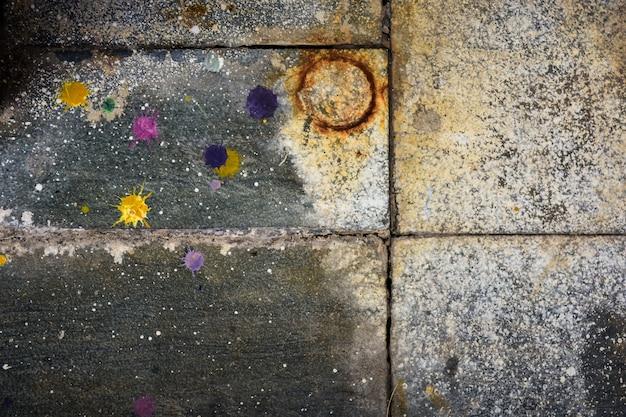 Textuur van cementmuur en vlekkleurenachtergrond.