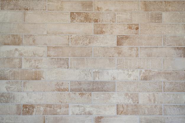 Textuur van crème oude grunge bakstenen muur