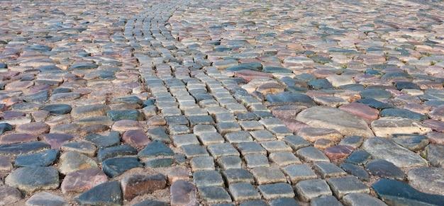 Textuur van de bestrating van stenen tegels achtergrond van keienbakstenen