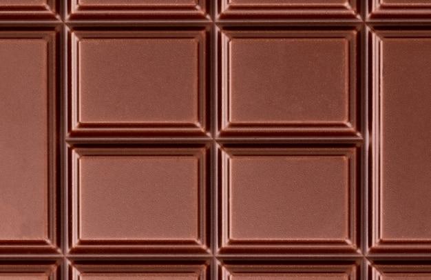 Textuur van de melkchocoladereep van bovenaanzicht.