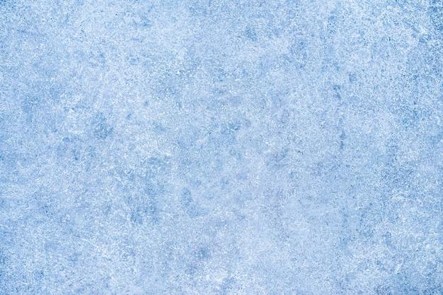 Textuur van de oude muur. armoedige blauwe verf met scheuren. gebarsten betonnen vintage achtergrond.