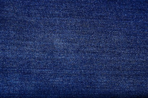 Textuur van de stoffenachtergrond van denimjeans.