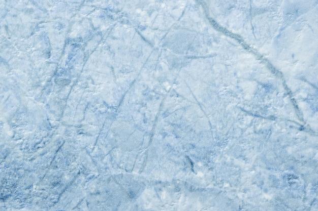 Textuur van decoratief lichtblauw gips, stenen muur.