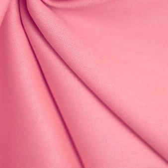 Textuur van delicate roze stof. selectieve zachte focus.