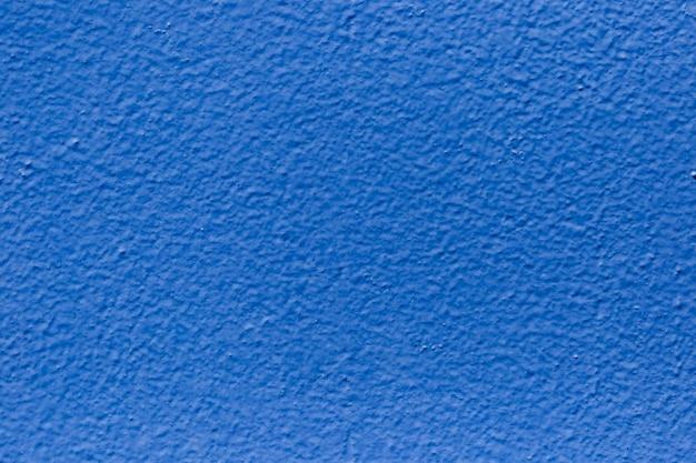 Textuur van dichte omhoog geschilderde muur